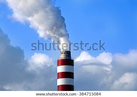 Industry chimney emitting smoke. - stock photo