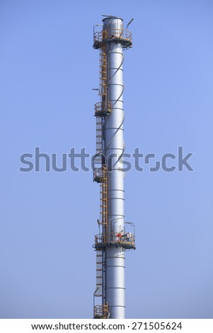 industry chimney tube against clear blue sky use for industrial scene and background - stock photo