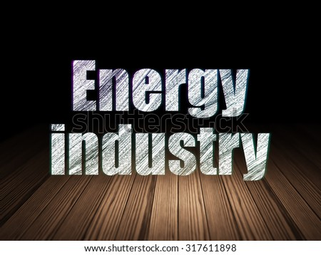 Industry concept: Glowing text Energy Industry in grunge dark room with Wooden Floor, black background