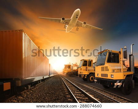 industry container trains running on railways track plane cargo flying above and ship transport in import export container yard   - stock photo