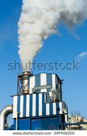 Industry factory against the sky - stock photo