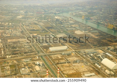 Industry in the fog near the Venice (Italy). View from the air. - stock photo