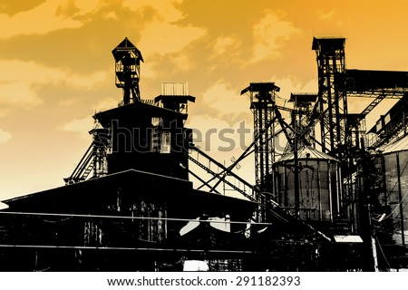 industry silhouettes as against a background of yellow sunset sky
