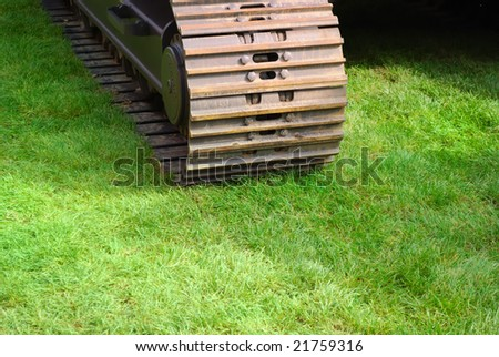 Industry treads on nature. Iron and grass very close - stock photo