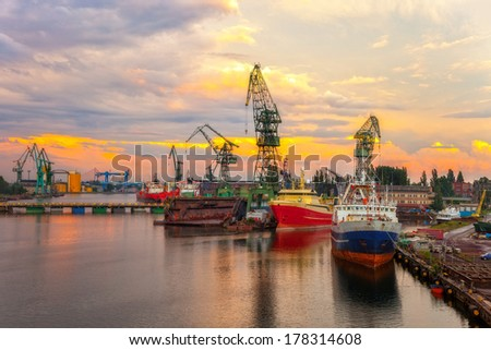 Industry view - Sunset in shipyard of Gdansk, Poland.  - stock photo