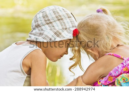inexperienced boy's feeling for the girl. first love. - stock photo