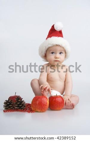 Infant and Christmas decoration,on white background. - stock photo