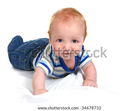 Infant Baby Boy Lying on His Tummy on White Background