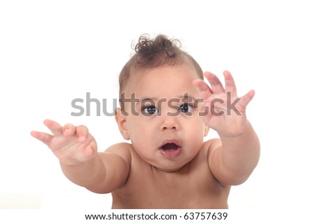 Infant baby boy reaching towards the viewer - stock photo