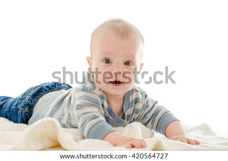 Infant baby boy smiling on a white blanket isolated on white