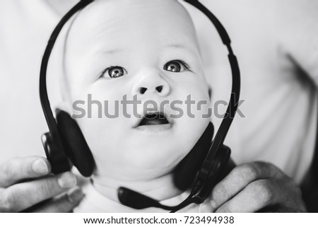 Infant Baby Child Boy Six Months Old with Headphones