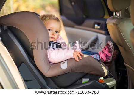 Infant baby girl in car seat - stock photo