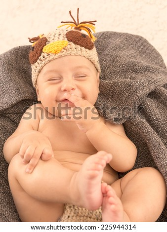 Infant Baby Laughing Out Loud Chuckle in an Owl Costume Happy Halloween Greeting Card - stock photo