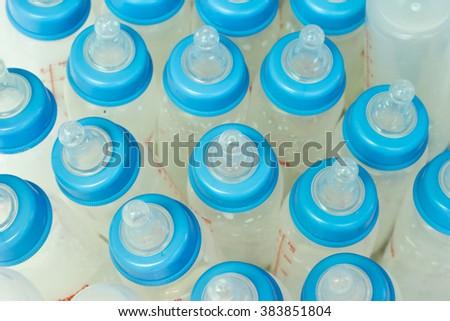 infant baby milk bottles feed - stock photo