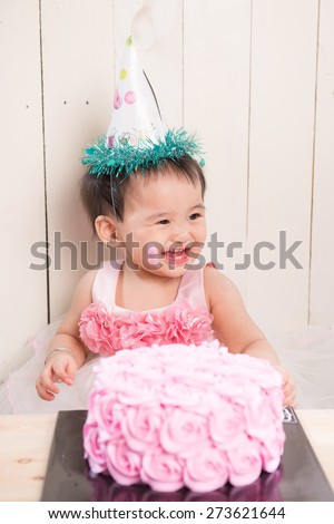 Infant boy's first birthday cake smash Adorable baby smashing cake - stock photo