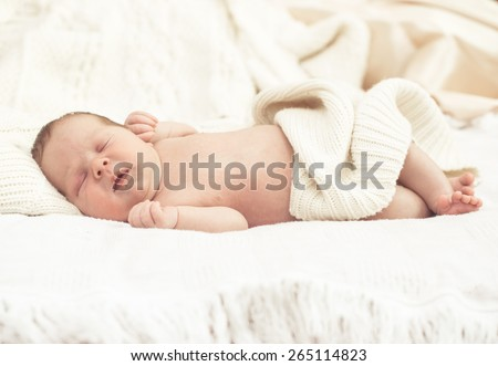 Infant boy sleeping in bed