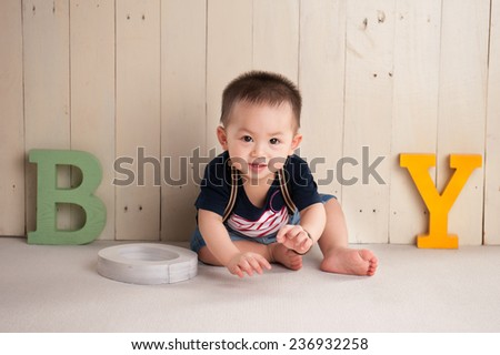 Infant child baby boy crawling happy smiling at home - stock photo