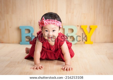 Infant child baby girl crawling happy smiling at home - stock photo