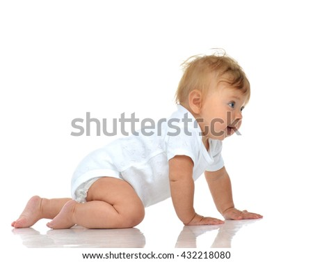Infant child baby girl in diaper crawling happy looking at the camera isolated on a white background