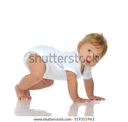 Infant child baby girl in diaper crawling happy looking at the corner trying to stand up isolated on a white background