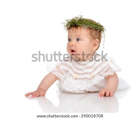 Infant child baby girl in diaper lying happy in circlet of flowers on head isolated  on a white background  