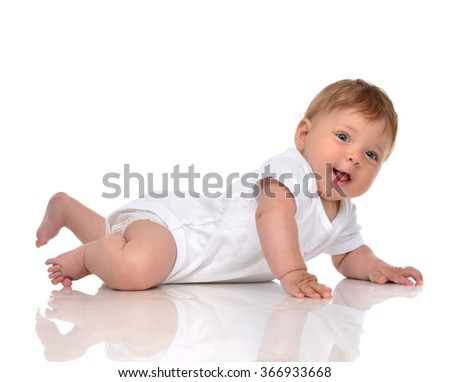 Infant child baby girl in diaper lying happy smiling looking at the camera isolated on a white background - stock photo
