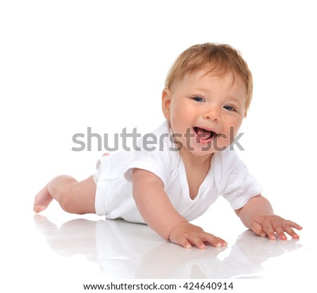 Infant child baby girl in lying happy smiling laughing isolated on a white background - stock photo
