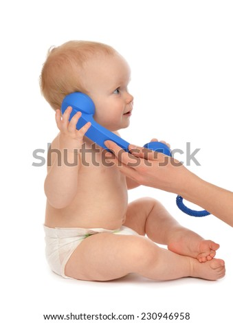 Infant child baby kid girl playing calling by phone on a white background