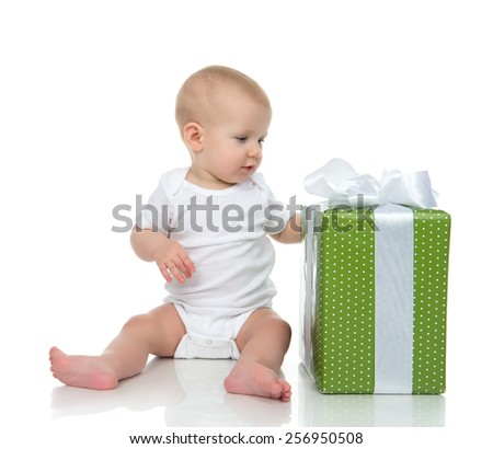 Infant child baby toddler kid with green present gift for birthday isolated on a white background - stock photo