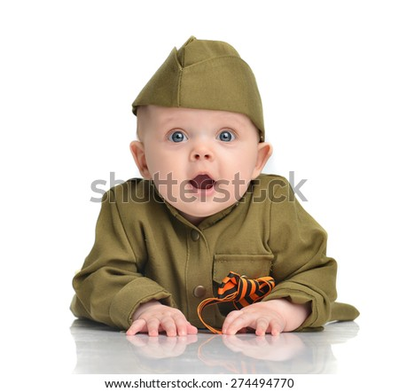 Infant child baby toddler lying in green military soldier uniform with St Georges ribbon flag on a white background 70 years of victory in World War II - stock photo