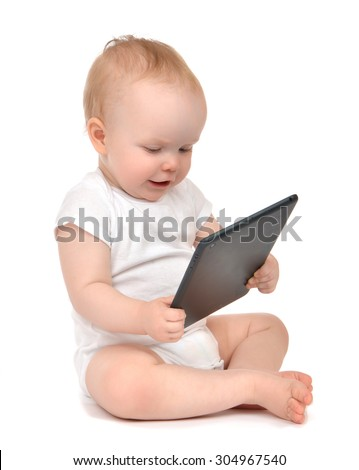 Infant child baby toddler sitting and typing digital tablet mobile computer isolated on a white background - stock photo