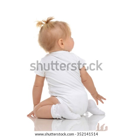 Infant child baby toddler sitting backwards back view and looking up isolated on a white background