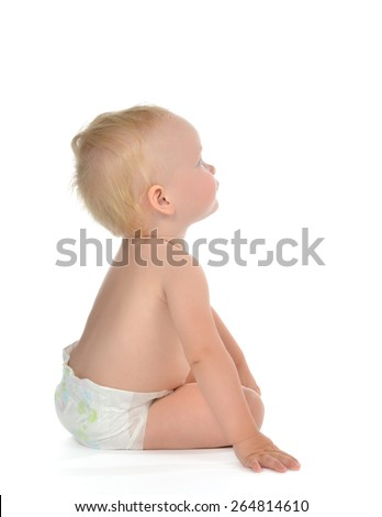 Infant child baby toddler sitting backwards happy looking up at the corner naked in diaper on a white background - stock photo