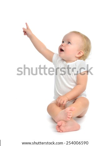 Infant child baby toddler sitting raise hand up pointing finger at the corner isolated on a white background - stock photo