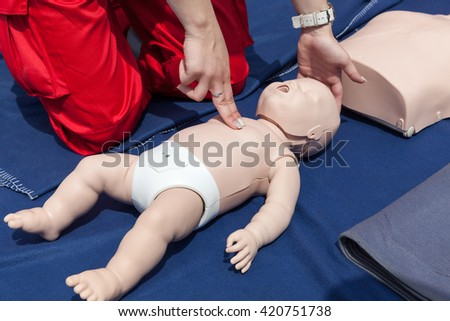 Infant CPR manikin first aid. Cardiopulmonary resuscitation - CPR.