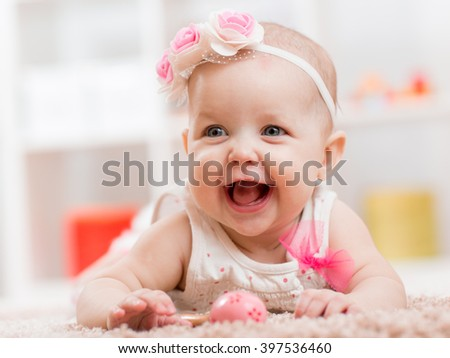 infant five months ago lying on belly - stock photo