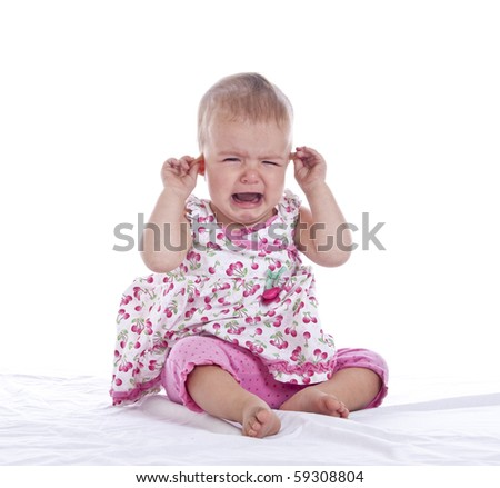 infant girl with ear ache, isolated with clipping path - stock photo