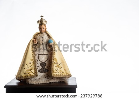 Infant Jesus of Prague in gold vestments on a white background - stock photo