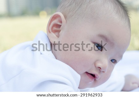 Infant lying on the grass