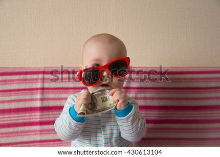Infant playing with money - stock photo