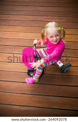 Infant preschool girl playing outdoor - stock photo