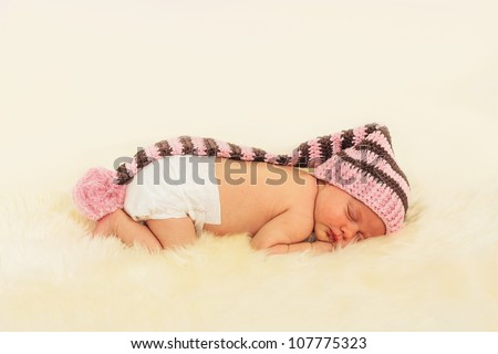 infant sleeping in the white sheep's clothing.