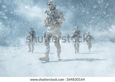 infantrymen in action - stock photo