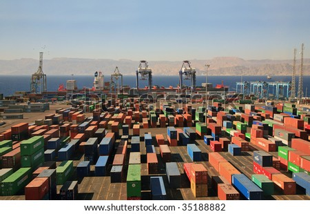infinitely many containers in a cargo port on red sea - stock photo