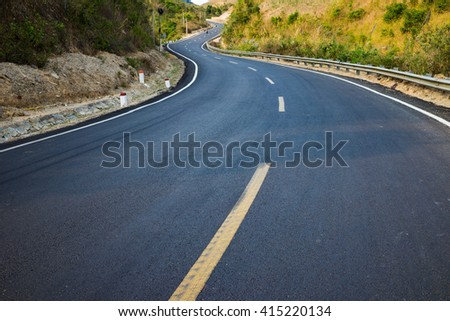 Infinity curved road with yellow line. Concept of adventure, travel, success...