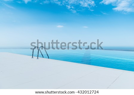 Infinity pool on the bright summer day - stock photo