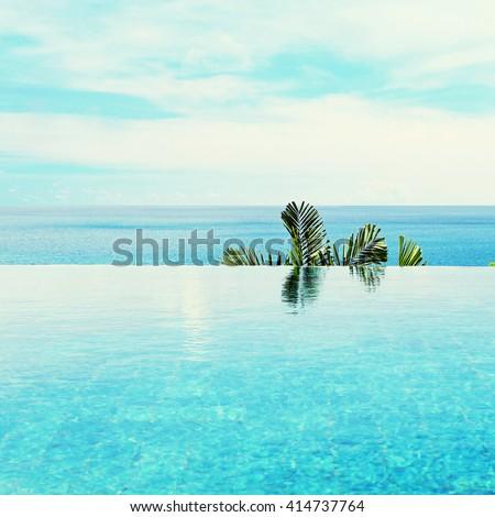 infinity pool with sea views - stock photo