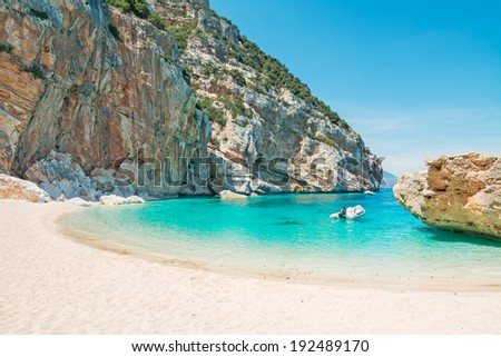 inflatable boat in Cala Mariolu, Sardinia - stock photo