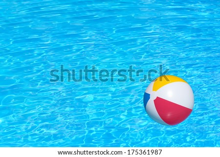 Inflatable colorful ball floating in a swimming pool