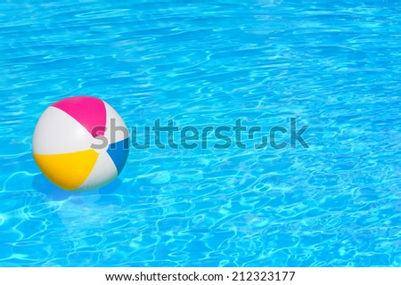 Inflatable colorful ball floating in the swimming pool